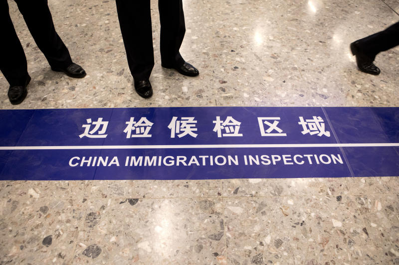 A sign reading China Immigration Inspection is displayed on the ground in the Mainland Port Area at West Kowloon Station, which houses the terminal for the Guangzhou-Shenzhen-Hong Kong Express Rail Link (XRL) in Hong Kong, Saturday, Sept. 22, 2018. (Giulia Marchi/Pool Photo via AP)