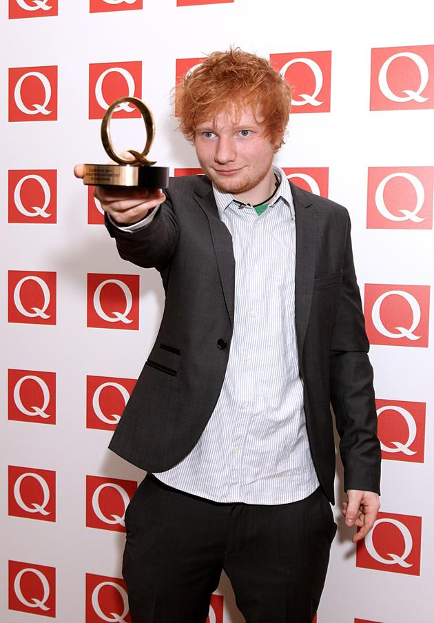 Ed Sheeran looked pleased with his win for 'Breakthrough Artist.' Well deserved, we think.