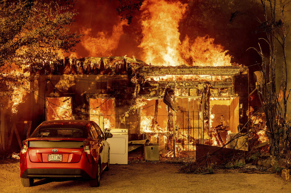 Fire consumes a home as the Sugar Fire, part of the Beckwourth Complex Fire, tears through Doyle, Calif., on Saturday, July 10, 2021. Pushed by heavy winds, the fire came out of the hills and destroyed multiple residences in central Doyle. (AP Photo/Noah Berger)