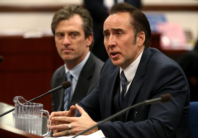 CORRECTS SPELLING OF NICOLAS - Actor Nicolas Cage testified in support of a bill proposing tax incentives to filmmakers at the Legislative Building Carson City, Nev., on Tuesday, May 7, 2013. Proponents of the measure say it will bring jobs and revenue to the state. Cage's agent Michael Nilon is at left. (AP Photo/Cathleen Allison)