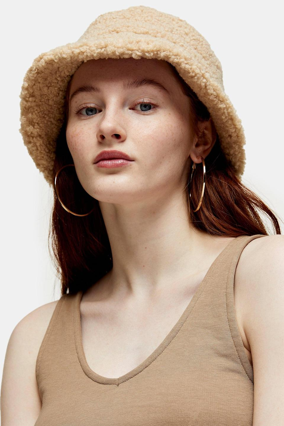 <p>This is for the friend who only wears neutral colors. They can pair this <span>Cream Borg Bucket Hat</span> ($32) with literally any look. </p>