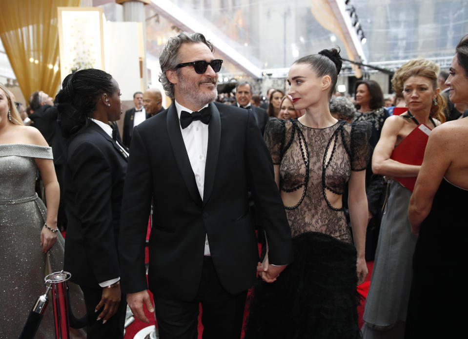 Joaquin Phoenix, left, and Rooney Mara arrive at the Oscars on Sunday, Feb. 9, 2020, at the Dolby Theatre in Los Angeles. (AP Photo/John Locher)