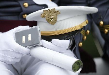 Graduate holds his diploma and lieutenant bars during commencement at West Point