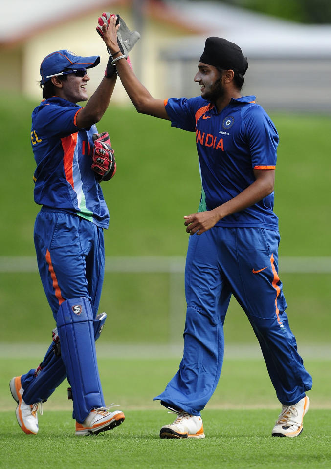 TOWNSVILLE, AUSTRALIA - APRIL 15:   Smit Kamlesh Patel (L) and Harmeet Singh of India celebrate the wicket  of William Bosisto of Australia during the match between Australia and India on day five of the U19 International Quad Series at Tony Ireland Stadium on April 15, 2012 in Townsville, Australia.  (Photo by Ian Hitchcock/Getty Images)