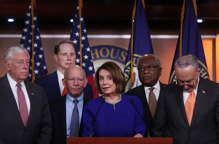 House Speaker Nancy Pelosi, Senate Minority Leader Chuck Schumer and other Democratic lawmakers speak to Capitol Hill reporters on May 22. (Photo: Jonathan Ernst/Reuters)