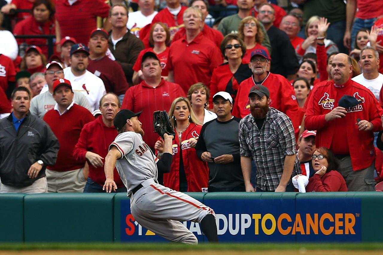 ST LOUIS, MO - OCTOBER 17:  Hunter Pence #8 of the San Francisco Giants catches a ball in right field hit by Allen Craig #21 of the St. Louis Cardinals in the fourth inning in Game Three of the National League Championship Series at Busch Stadium on October 17, 2012 in St Louis, Missouri.  (Photo by Elsa/Getty Images)