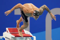 Caeleb Dressel, of United States, starts the men's 50-meter freestyle final at the 2020 Summer Olympics, Sunday, Aug. 1, 2021, in Tokyo, Japan. (AP Photo/David Goldman)