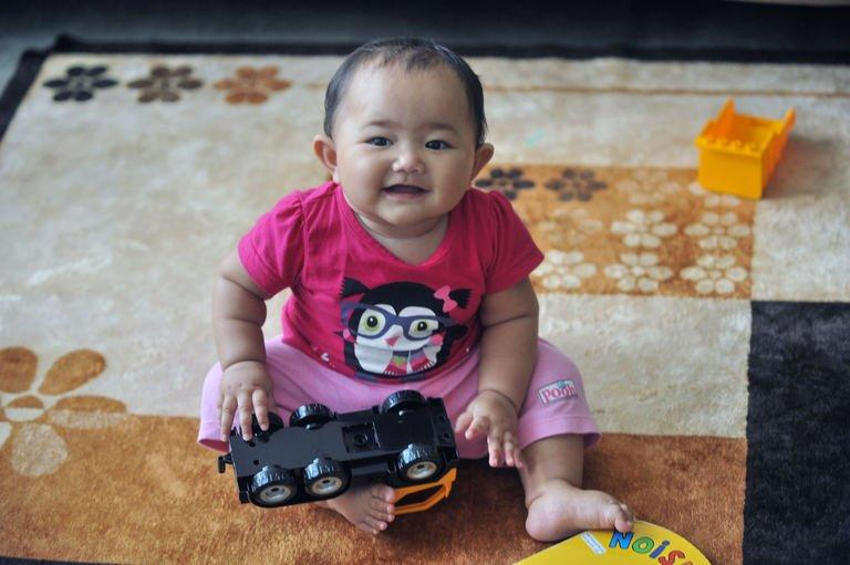 A young Singaporean baby plays at her home in Singapore on January 21, 2013