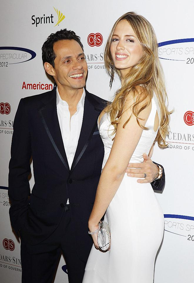 "Marc Anthony didn't waste time when it came to showing the world that he'd moved on from his July 2011 split with the multi-talented Jennifer Lopez. By New Year's, while J.Lo was off with her new boy toy Casper Smart, Anthony, 43, had cozied up to Venezuelan model Shannon De Lima, 24. And he made sure everyone knew about it! He even sent his new lady love a more modern version of the love letter – a Spanish tweet which when translated into English means, ""To Shannon, my statue of liberty. Kisses baby!"" The singer then went on to post a pic of he and De Lima kissing on his Facebook page. OK, Marc, you're dating again, we get it!"