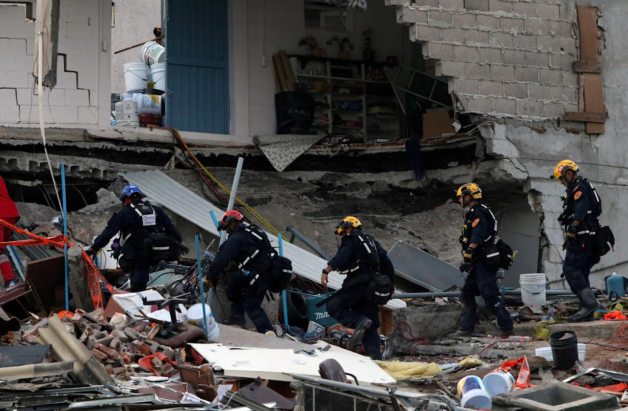 Members of rescue team search for survivors in the rubble of a collapsed building after an earthquake in Mexico City, Mexico September 23, 2017. REUTERS/Henry Romero