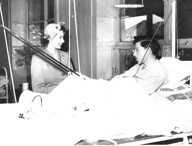 Handout photo of Britain's Princess Elizabeth visiting a Red Cross hut for tuberculosis patients