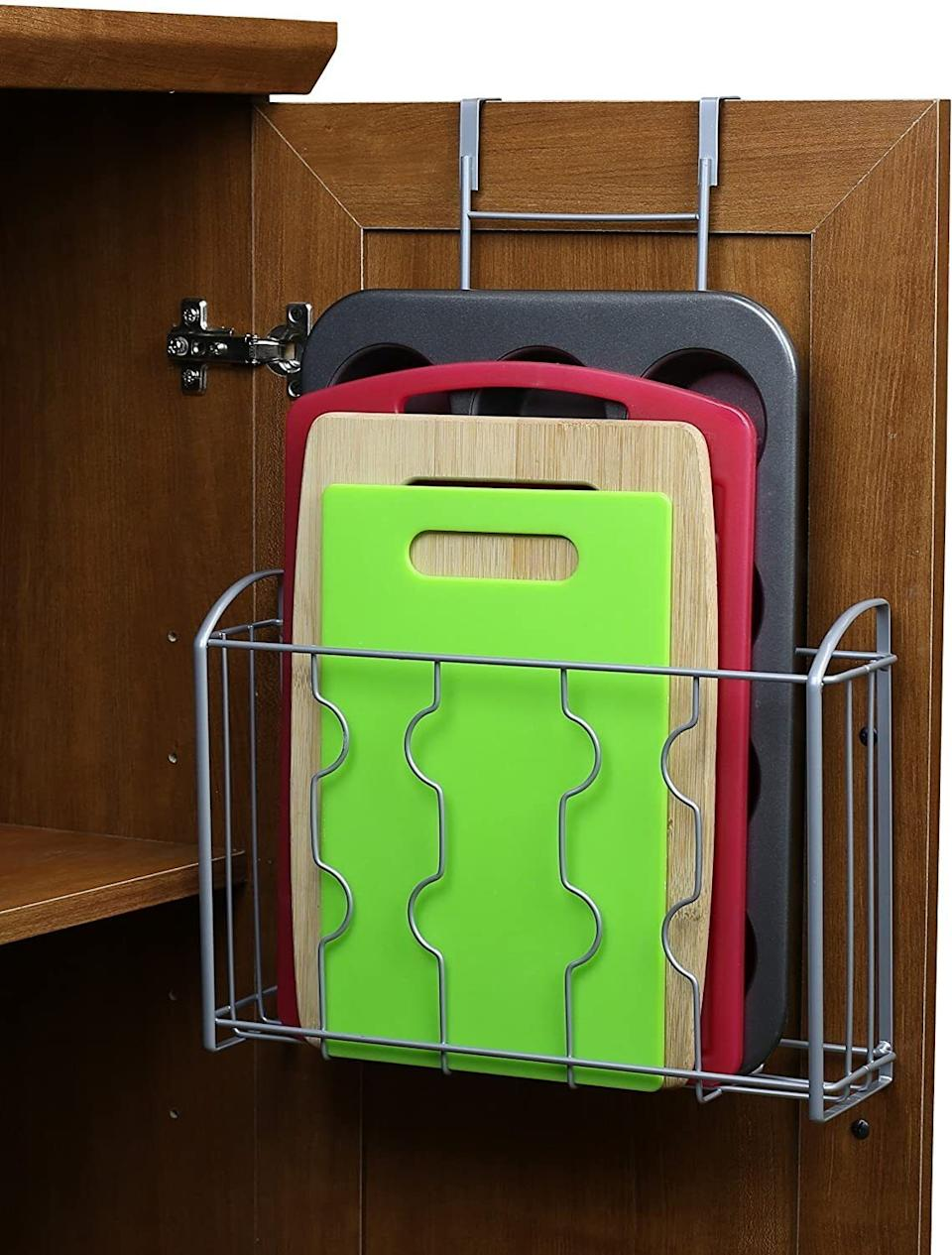 """Give your awkwardly shaped plastic wrap and cutting boards a nice home of their own.<br /><br /><strong>Promising review:</strong>""""This organizer is so useful!<strong>I recently moved and ended up with a much smaller kitchen, so I've been doing everything I can to make sure there's a place for everything and no wasted space.</strong>Luckily, I have pretty wide cabinets, so this works out perfectly. I have one holding my cutting boards (four standard plastic boards) and another holding my foil, cling wrap, and parchment paper boxes. The organizer is super easy to assemble and it's completely versatile.<strong>Hang it over the cabinet door or attach it to the wall/cabinet door, which means it's great for renters and owners.</strong>"""" —<a href=""""https://www.amazon.com/dp/B01LXKKVPK?tag=huffpost-bfsyndication-20&ascsubtag=5834502%2C9%2C46%2Cd%2C0%2C0%2C0%2C962%3A1%3B901%3A2%3B900%3A2%3B974%3A3%3B975%3A2%3B982%3A2%2C16267119%2C0"""" target=""""_blank"""" rel=""""noopener noreferrer"""">Kerry</a><br /><br /><strong>Get it from Amazon for<a href=""""https://www.amazon.com/dp/B01LXKKVPK?tag=huffpost-bfsyndication-20&ascsubtag=5834502%2C9%2C46%2Cd%2C0%2C0%2C0%2C962%3A1%3B901%3A2%3B900%3A2%3B974%3A3%3B975%3A2%3B982%3A2%2C16267119%2C0"""" target=""""_blank"""" rel=""""noopener noreferrer"""">$14.97</a>.</strong>"""