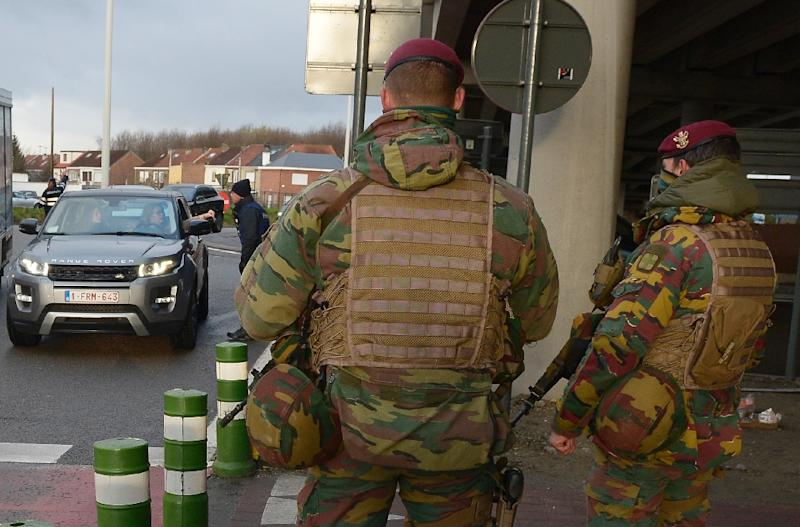 Police and soldiers check Brussels airport employees in Zaventem as they return for a large-scale test run to determine if services could partially resume
