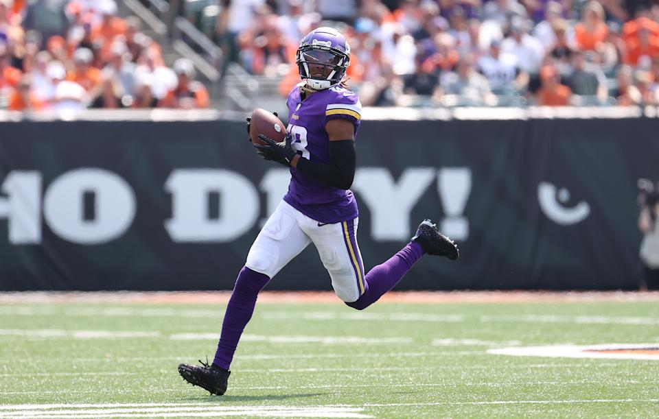 CINCINNATI, OHIO - SEPTEMBER 12: Justin Jefferson #18 of the Minnesota Vikings runs with the ball against the  Cincinnati Bengals   at Paul Brown Stadium on September 12, 2021 in Cincinnati, Ohio. (Photo by Andy Lyons/Getty Images)