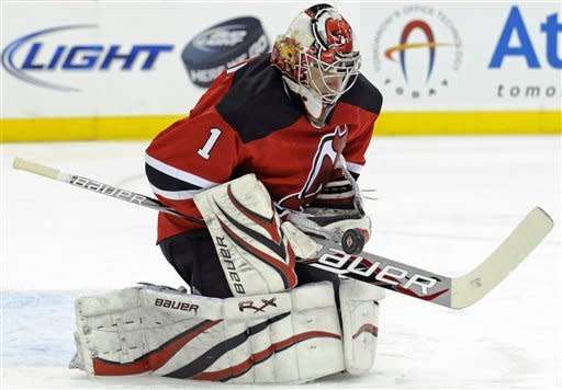 New Jersey Devils goaltender Johan Hedberg, of Sweden, makes a save during the first period of an NHL hockey game against the Florida Panthers, Friday, Jan. 6, 2012, in Newark, N.J. (AP Photo/Bill Kostroun)