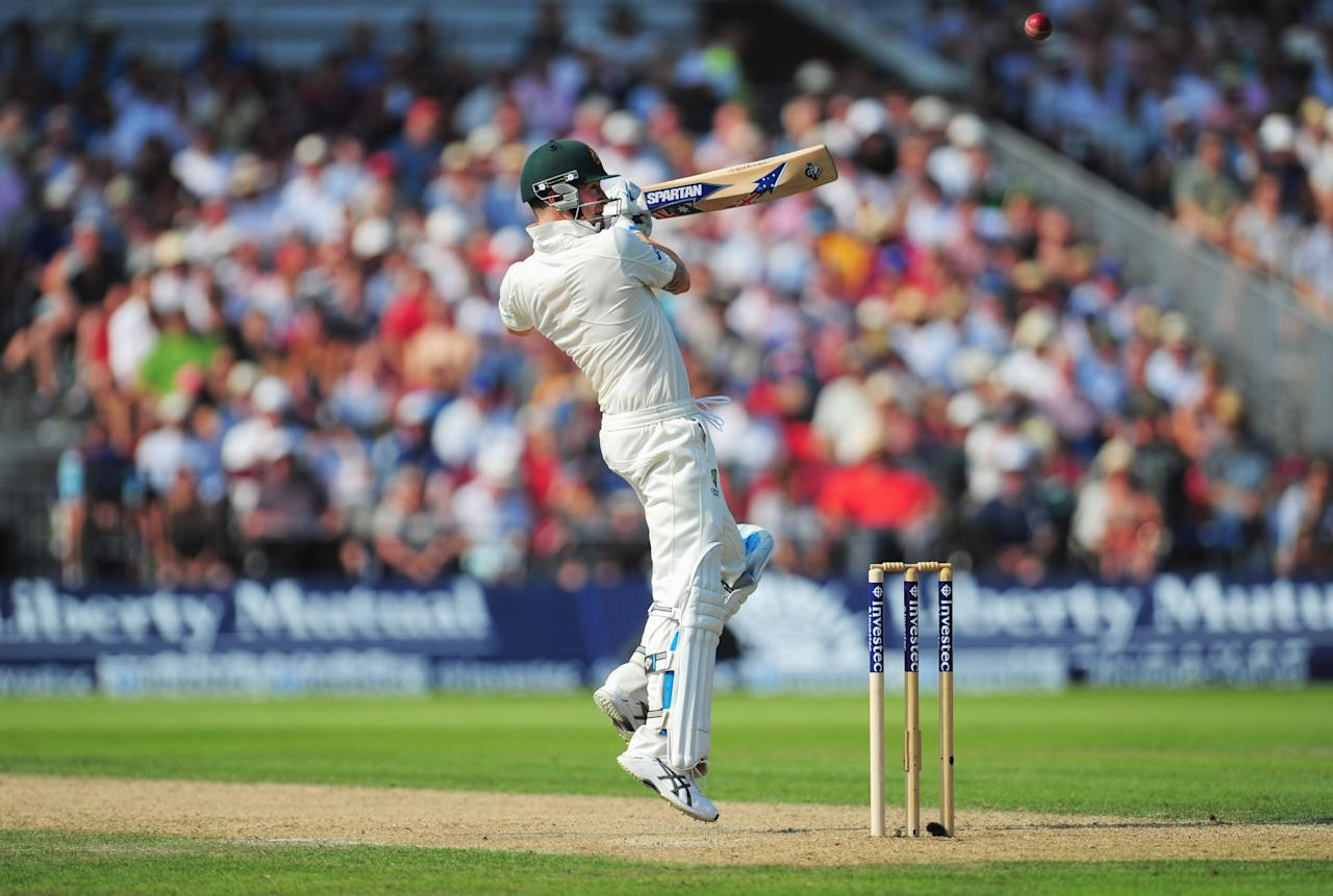 MANCHESTER, ENGLAND - AUGUST 01: Michael Clarke of Australia hits out during day one of the 3rd Investec Ashes Test match between England and Australia at Old Trafford Cricket Ground on August 1, 2013 in Manchester, England. (Photo by Stu Forster/Getty Images)