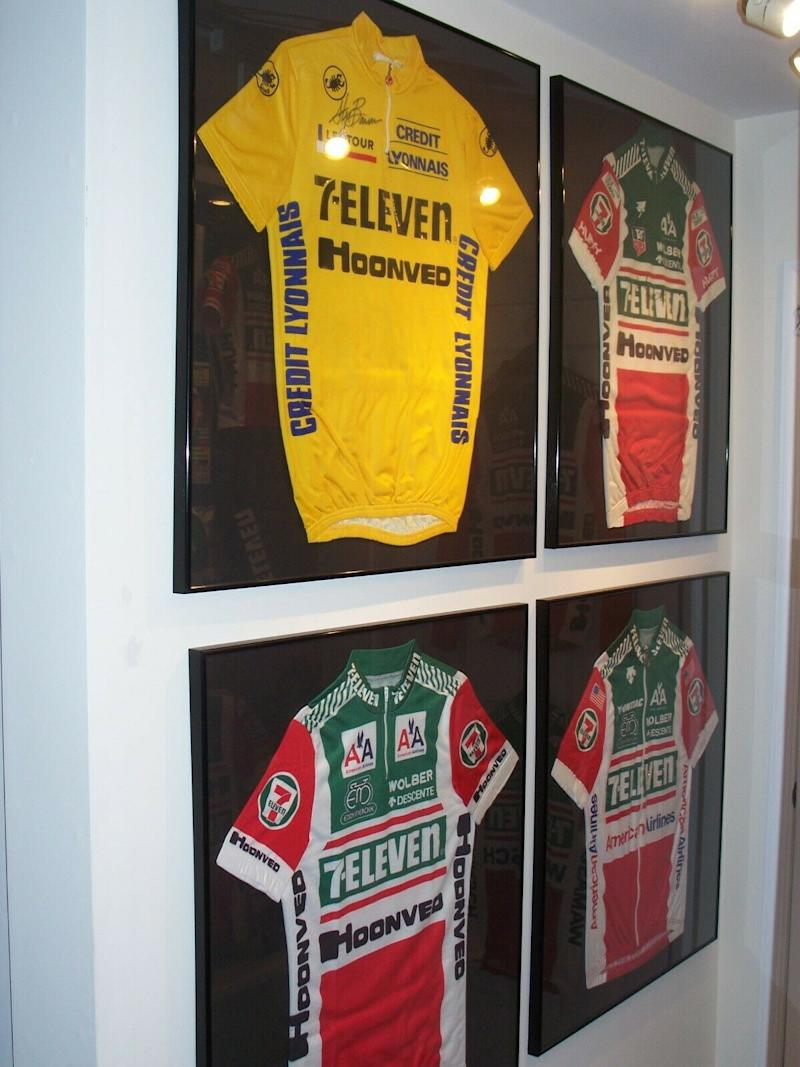 Andy Hampsten's signed jersey, with two other 7-Eleven team jerseys, and Steve Bauer's 1990 Tour de France yellow jersey
