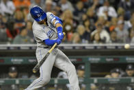 Kansas City Royals' Whit Merrifield hits a sacrifice fly, scoring Kyle Isbel, in the eighth inning of a baseball game against the Detroit Tigers, Friday, Sept. 24, 2021, in Detroit. (AP Photo/Jose Juarez)
