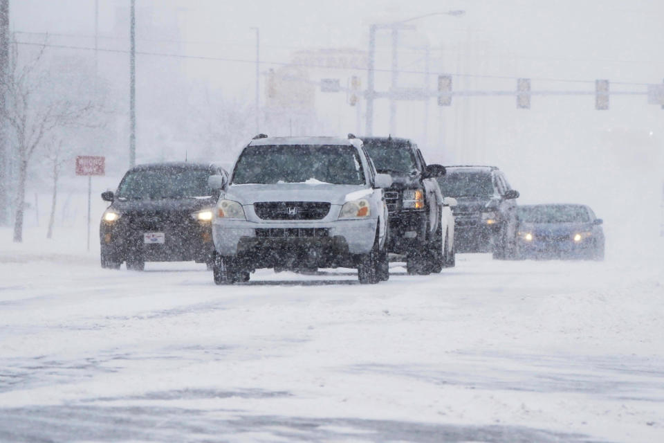 Drivers make their way along a road during a winter storm in Oklahoma City. Source: AP