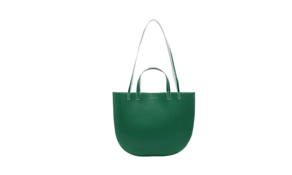 "<p>The perfect, easy-breezy tote for work, food shopping or a leisurely weekend.<br><br>Round Edge Oversized Tote, $69, <a href=""https://www.charleskeith.com/us/bags/bags-all/round-edge-oversized-tote-green-ck2-30150713.html"" rel=""nofollow noopener"" target=""_blank"" data-ylk=""slk:charleskeith.com"" class=""link rapid-noclick-resp"">charleskeith.com</a> </p>"