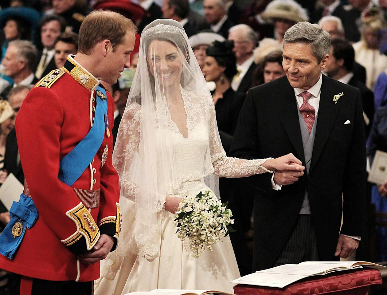 Prince William greets Kate Middleton as she arrives at the alter with her father Michael Middleton, prior to their marriage in London's Westminster Abbey, Friday April 29 2011.