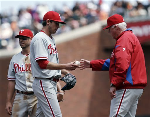 Philadelphia Phillies starting pitcher Jonathan Pettibone, front left, is pulled from the baseball game against the San Francisco Giants by manager Charlie Manuel during the sixth inning Wednesday, May 8, 2013, in San Francisco. (AP Photo/Marcio Jose Sanchez)