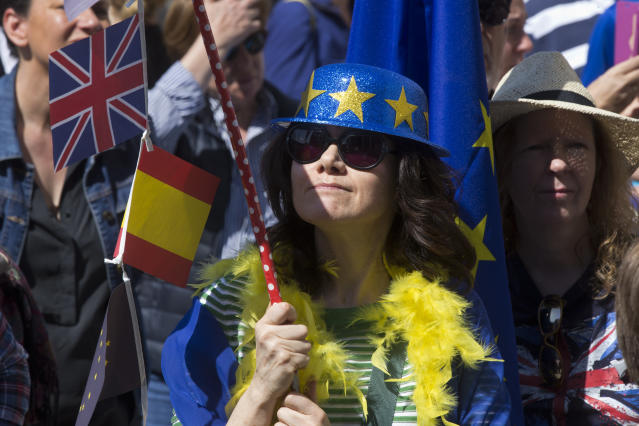 A woman wearing a hat with the EU flag, holds a pole with a British and Spanish flag during an anti Brexit protest in the Plaza Margaret Thatcher in Madrid, Spain, Saturday, March 23, 2019. Coinciding with the anti Brexit march in London, the Eurocitizens campaign group have organized a protest in the Spanish capital calling for the protection of British citizens living in Spain while asking for a second Brexit referendum. (AP Photo/Paul White)