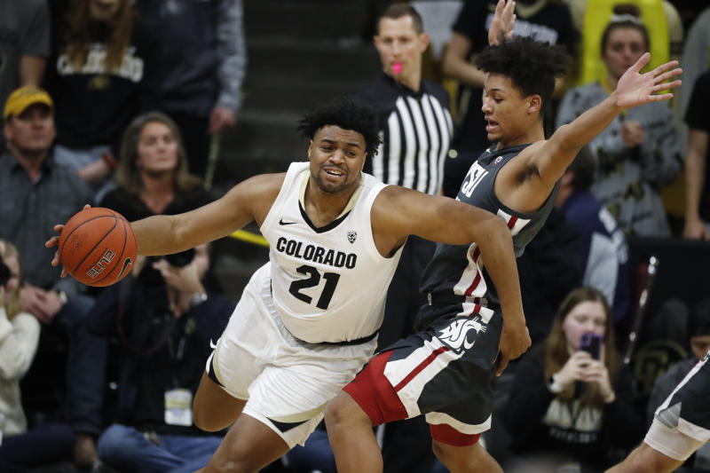 Colorado forward Evan Battey, left, drives past Washington State forward DJ Rodman in the first half of an NCAA college basketball game Thursday, Jan. 23, 2020, in Boulder, Colo. (AP Photo/David Zalubowski)