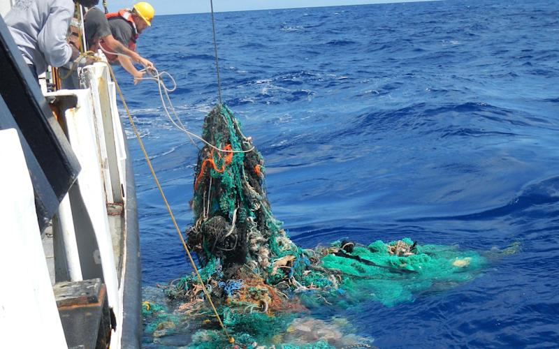 Researchers pulling in discarded fishing nets - The Ocean Cleanup Foundation