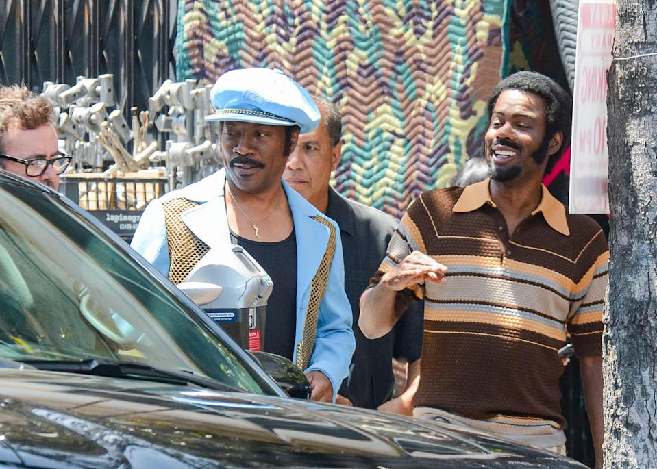 Chris Rock and Eddie Murphy on set together. (Photo: Getty Images)