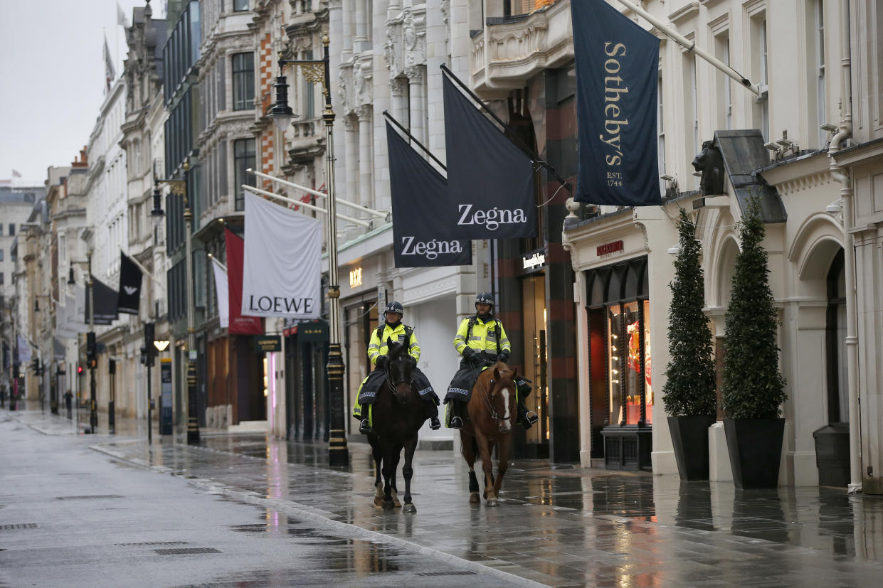 LONDON, ENGLAND - JANUARY 16: Mounted police pass luxury shops on New Bond Street in Mayfair on January 16, 2021, in London, England. With a surge of COVID-19 cases fuelled partly by a more infectious variant of the virus, British leaders have reimposed nationwide lockdown measures across England through at least mid February. (Photo by Hollie Adams/Getty Images)