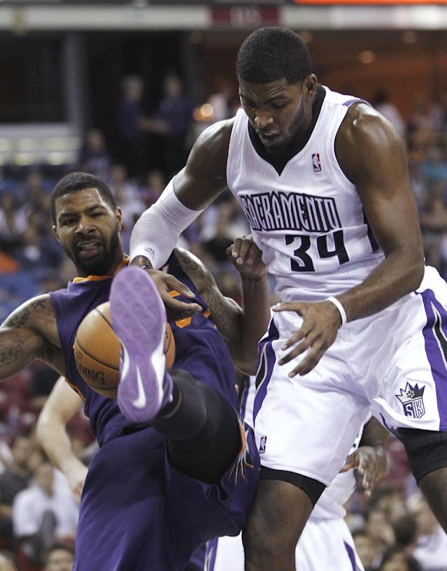 Phoenix Suns forward Marcus Morris, left, and Sacramento Kings forward Jason Thompson struggle for the ball during the first quarter of an NBA preseason basketball game in Sacramento, Calif., Thursday, Oct. 17, 2013.(AP Photo/Rich Pedroncelli)