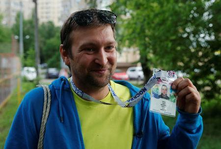 Soccer fan Pavel Cherkas, who was blacklisted by Russian authorities for bad behaviour at a stadium, demonstrates his 2018 World Cup fan ID, which was granted to Cherkas and later revoked, during an interview outside Moscow, Russia May 20, 2018. REUTERS/Maxim Shemetov