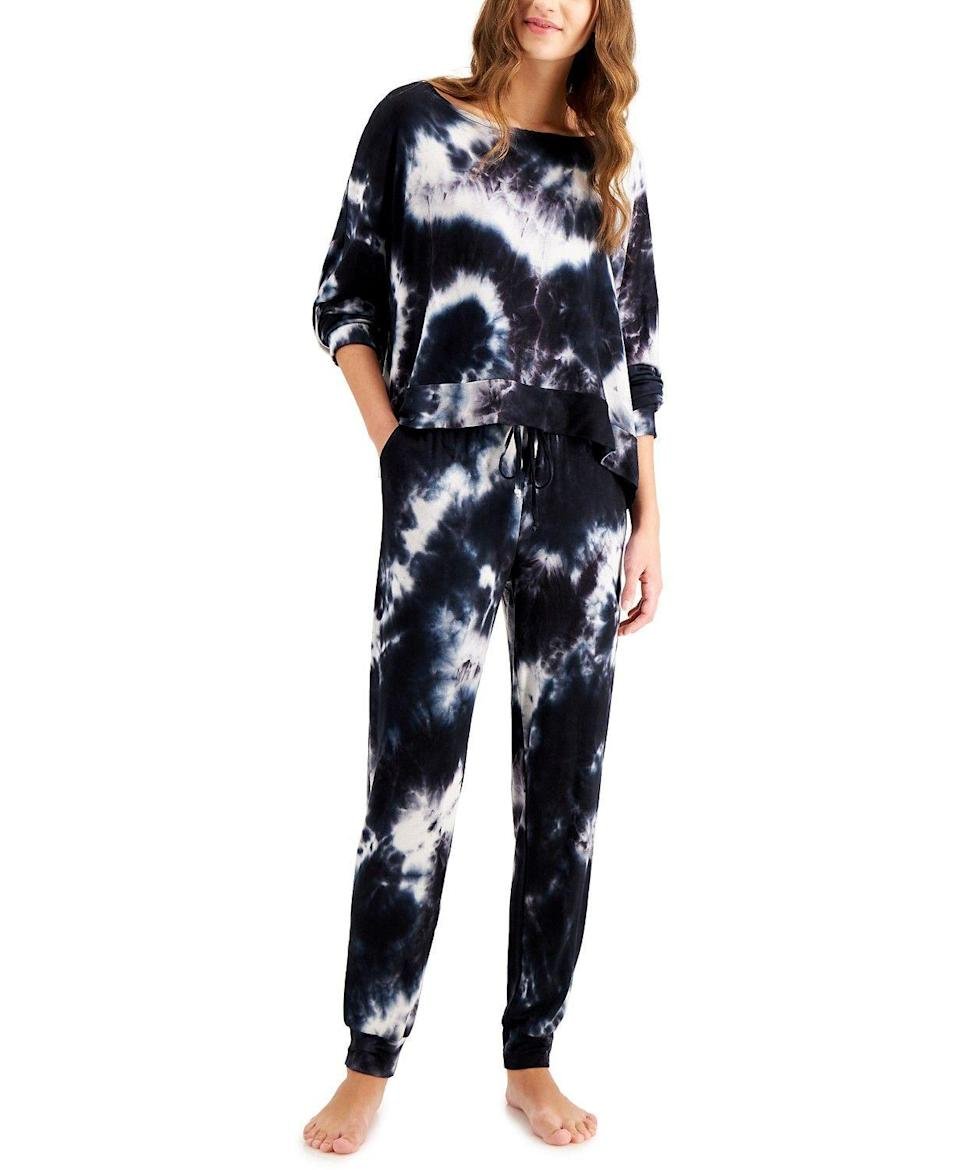 """<p><strong>Jenni</strong></p><p>macys.com</p><p><strong>$69.50</strong></p><p><a href=""""https://go.redirectingat.com?id=74968X1596630&url=https%3A%2F%2Fwww.macys.com%2Fshop%2Fproduct%2Fjenni-womens-tie-dyed-loungewear-set-created-for-macys%3FID%3D11798853&sref=https%3A%2F%2Fwww.cosmopolitan.com%2Fstyle-beauty%2Ffashion%2Fg35536095%2Fbest-hauliday-fashion-editor-picks%2F"""" rel=""""nofollow noopener"""" target=""""_blank"""" data-ylk=""""slk:Shop Now"""" class=""""link rapid-noclick-resp"""">Shop Now</a></p><p>Tie-dye lounge sets aren't going away any time soon, so this dark one with white contrast is where it's at. </p><p><strong>Sale:</strong> 30-40% off select items</p>"""