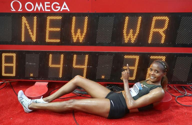 Kenya's Beatrice Chepkoech celebrates after her new world record in the women's 3000 metre steeplechase at the IAAF Diamond League athletics 'Herculis' meeting at The Stade Louis II Stadium in Monaco on July 20, 2018.Kenyan Beatrice Chepkoech ran 8min 44.32sec to set a new 3000m steeplechase world record at the Diamond League meet in Monaco