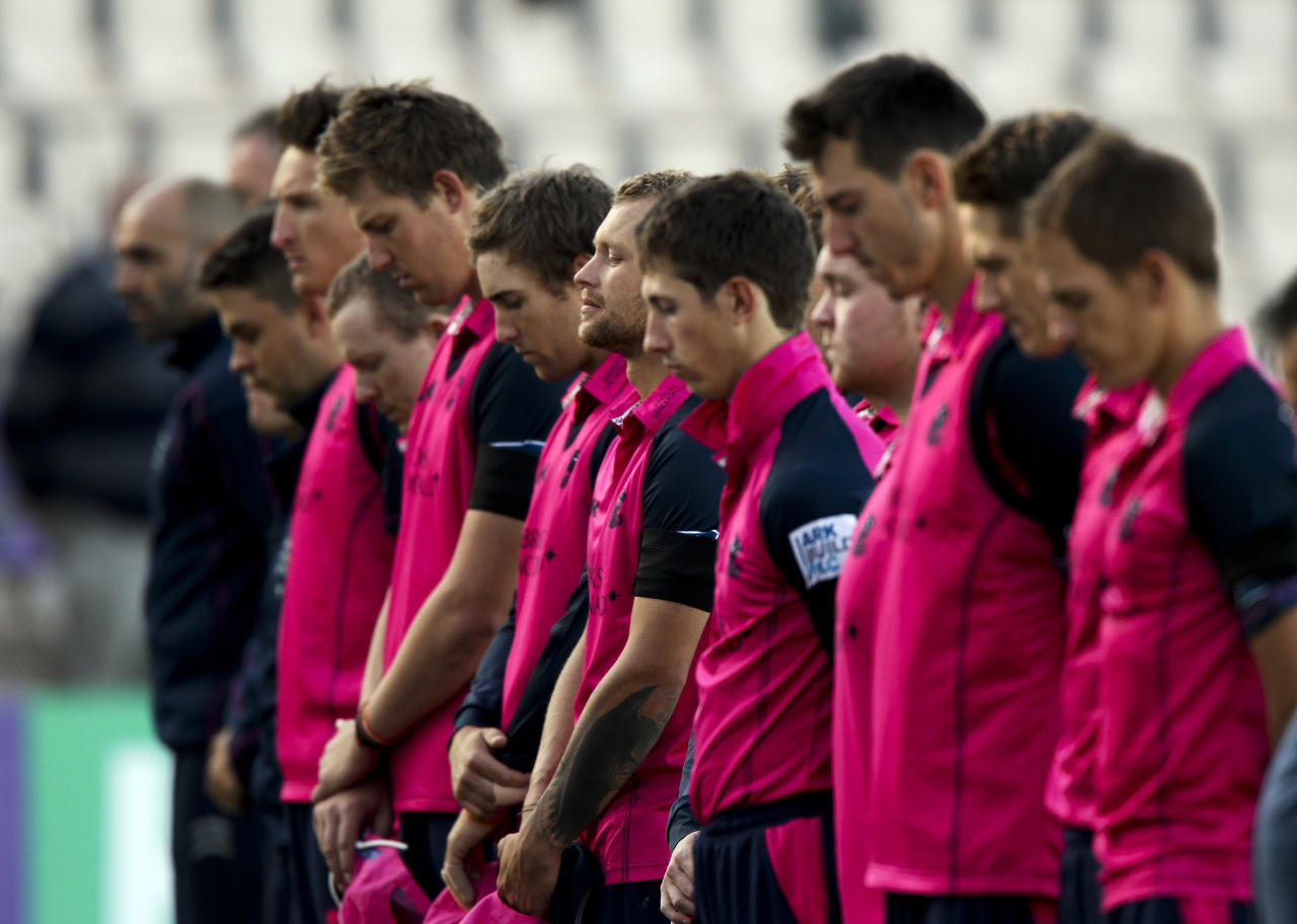 SOUTHAMPTON, ENGLAND - JUNE 18: Middlesex players observe a minutes silence in memory of Tom Maynard of Surrey during the Friends Life T20 match between Hampshire and Middlesex at the Ageas Bowl on June 18, 2012 in Southampton, England. (Photo by Ben Hoskins/Getty Images)
