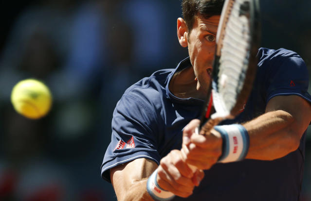 <p>Novak Djokovic hits a return to Rafael Nadal during their mens semifinal tennis match at the Madrid Open tennis tournament in Madrid, Spain, May 13, 2017. (Photo: Francisco Seco/AP) </p>