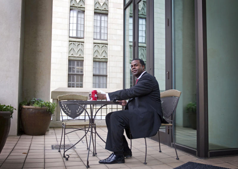 In this Dec. 22, 2010 photo, Atlanta Mayor Kasim Reed works on the balcony of his city hall office in Atlanta. In the nearly 18 months since he's been at the helm, Reed finds himself at a crossroads. As Atlanta's 59th mayor, he has been a fixture in Washington during his tenure, meeting with federal officials to press the city's and the state's priorities to the administration, while juggling city priorities like the budget and jobs and cementing Atlanta's role as the capital of the South in the tradition of his predecessors. (AP Photo/David Goldman)