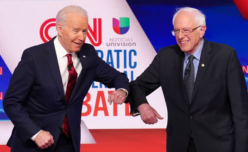 FILE PHOTO: Democratic U.S. presidential candidates Senator Bernie Sanders and former Vice President Joe Biden at the 11th Democratic candidates debate of the 2020 U.S. presidential campaign in Washington