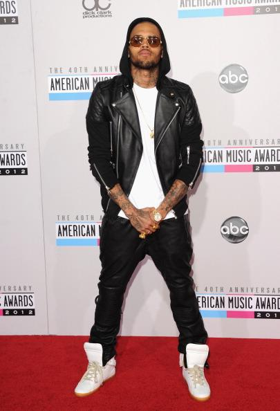 Chris Brown arrives on the 2012 American Music Awards red carpet.