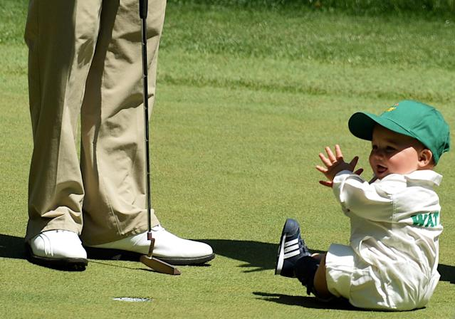 Bubba Watson of the US and son Caleb during the Par 3 Contest held the day before the start of the 77th Masters golf tournament at Augusta National Golf Club on April 10, 2013 in Augusta, Georgia. AFP PHOTO / JEWEL SAMADJEWEL SAMAD/AFP/Getty Images
