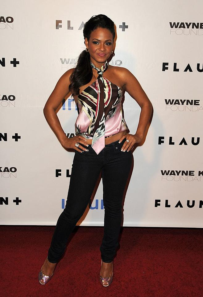 "Christina Milian's sexy halter top also boasted a bold print. Jordan Strauss/<a href=""http://www.wireimage.com"" target=""new"">WireImage.com</a> - December 18, 2008"