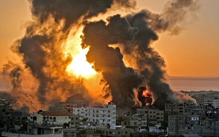 A fire rages at sunrise in Khan Yunish following an Israeli airstrike on targets in the southern Gaza strip - AFP Contributor#AFP