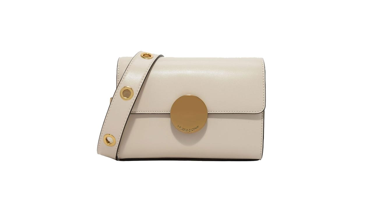 "<p>Circular Buckle Crossbody Bag, $59, <a rel=""nofollow"" href=""http://www.charleskeith.com/us/bags/circular-buckle-crossbody-bag-ivory-ck2-80680594.html"">charleskeith.com</a> </p>"