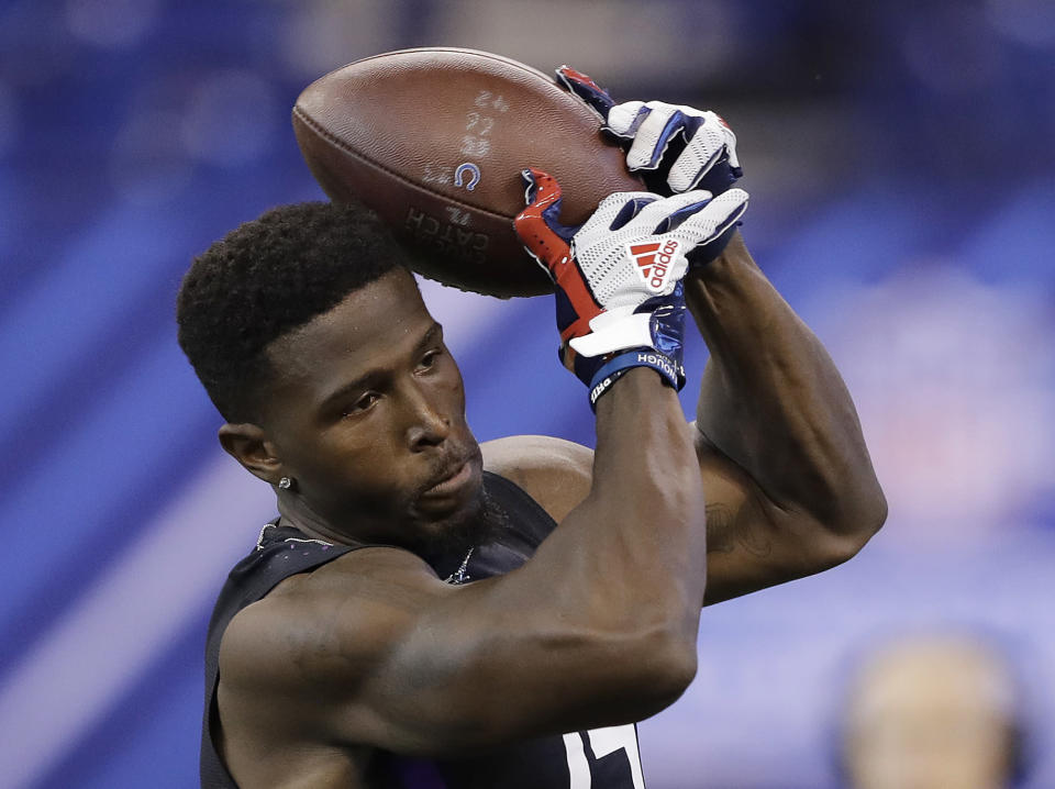 TCU running back Kyle Hicks runs a drill during the NFL football scouting combine, Friday, March 2, 2018, in Indianapolis. (AP Photo/Darron Cummings)