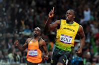 Usain Bolt of Jamaica celebrates winning gold in the Men?s 100m Final on Day 9 of the London 2012 Olympic Games at the Olympic Stadium on August 5, 2012 in London, England. (Photo by Stu Forster/Getty Images)
