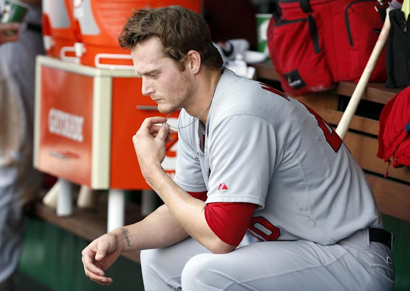 St. Louis Cardinals starting pitcher Shelby Miller sits in the dugout during the fourth inning of a baseball game against the Washington Nationals at Nationals Park Sunday, April 20, 2014, in Washington. (AP Photo/Alex Brandon)