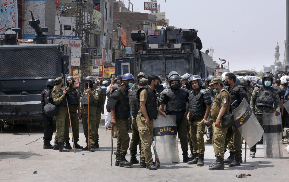 Police officers prepare to leave after conducting a crackdown against supporters of Tehreek-e-Labiak Pakistan, a banned Islamist party, protesting the arrest of their party leader, in Lahore, Pakistan, Sunday, April 18, 2021. A crackdown by security forces on protesting supporters of the banned party left several people dead and many others, including police officers, injured, a police spokesman said Sunday. (AP Photo/K.M. Chaudary)