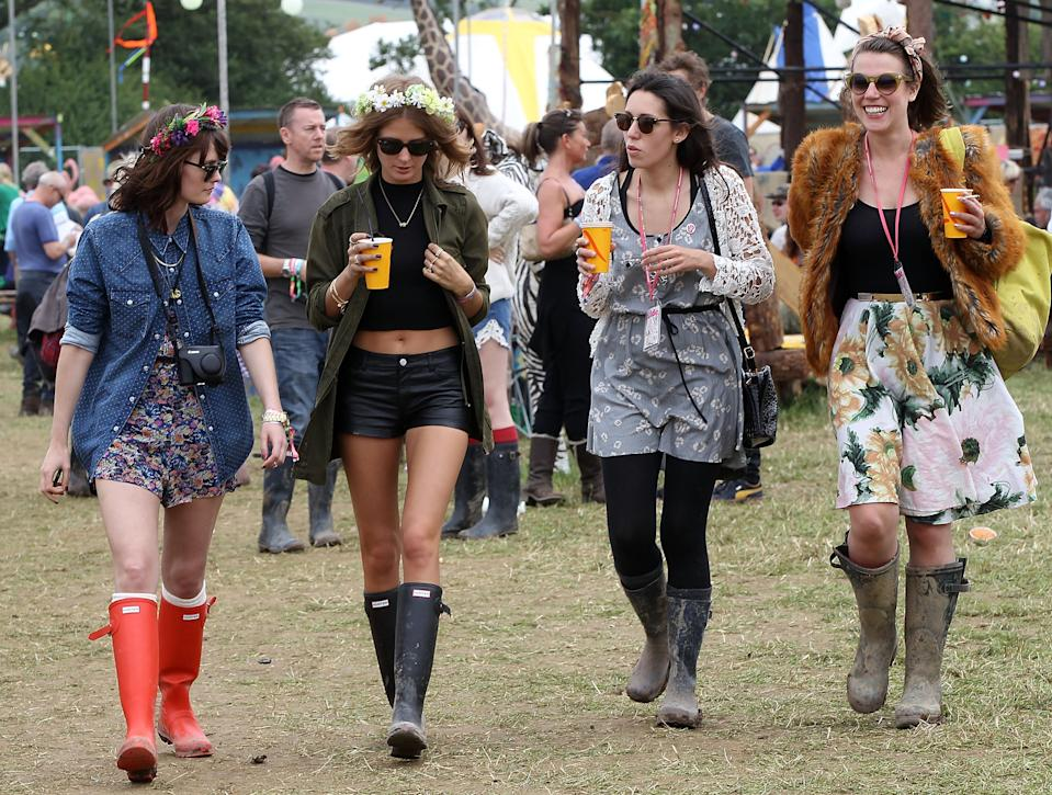 GLASTONBURY, ENGLAND - JUNE 28: Millie Mackintosh (2L) and friends attend day 2 of the 2013 Glastonbury Festival at Worthy Farm on June 28, 2013 in Glastonbury, England. (Photo by Danny Martindale/WireImage)
