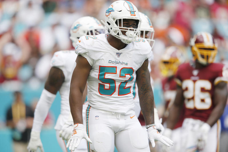 Raekwon McMillan #52 of the Miami Dolphins reacts after a tackle against the Washington Redskins during the first quarter at Hard Rock Stadium on October 13, 2019 in Miami, Florida. (Photo by Michael Reaves/Getty Images)